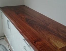 white kitchen , framed fronts, blackwood tops